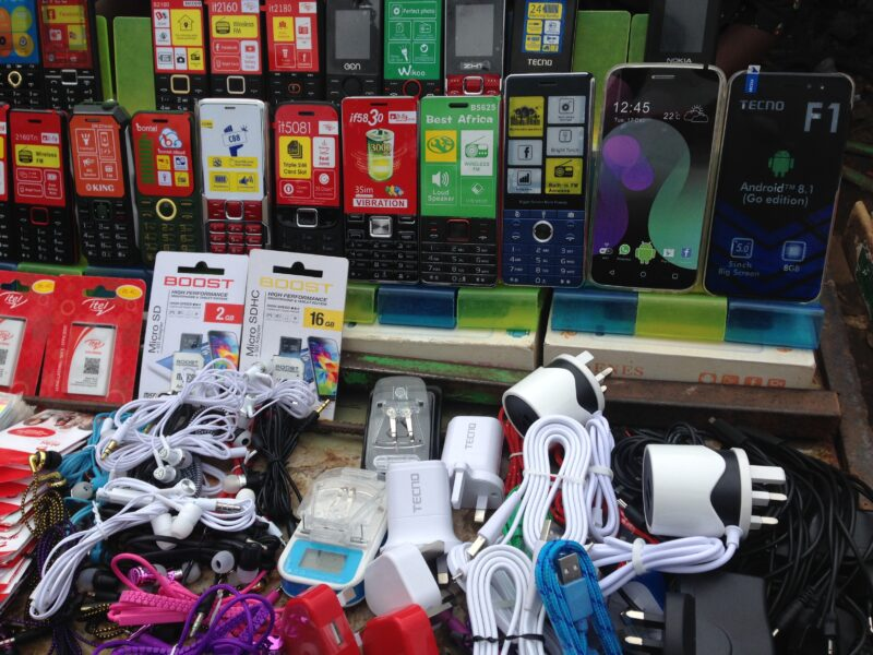 Mobile phone kiosk features mobile devices, plugs and other accesories.