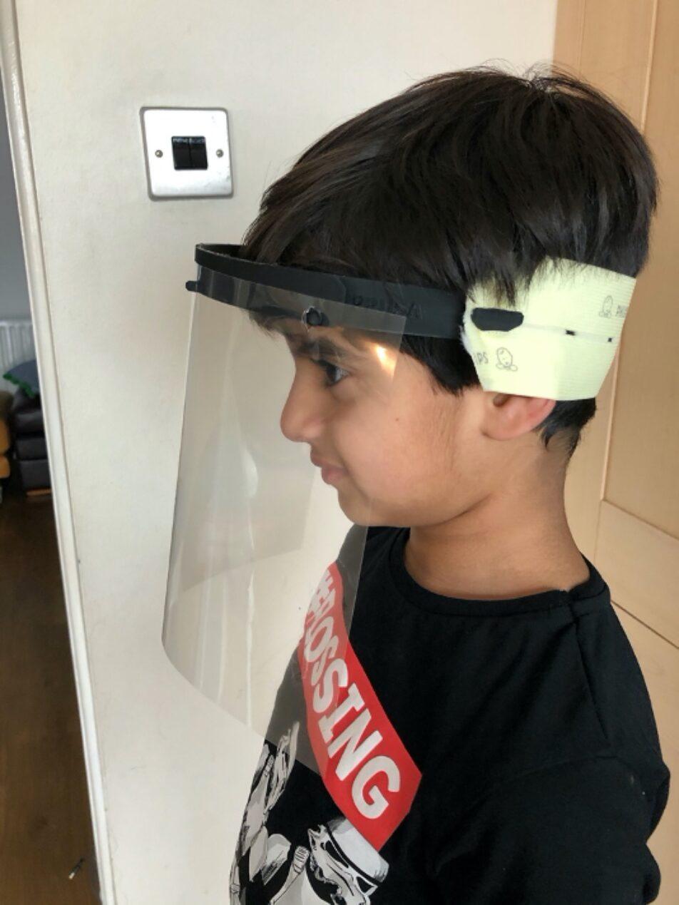 Maryam's son testing a face shield