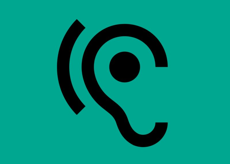 A line-drawing of the hearing aid symbol (an ear with a curved line around the outer edge of the ear), on a mint green background.