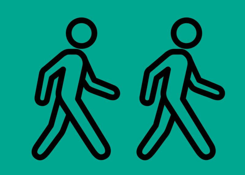 Two line drawings of walking people, on a mint green backround.
