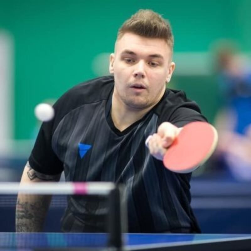 Jack Hunter-Spivey playing a game of table tennis. Hitting the ball towards the camera at speed