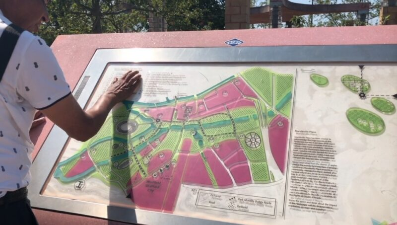 A blind individual touching the Queen Elizabeth Olympic Park tactile map