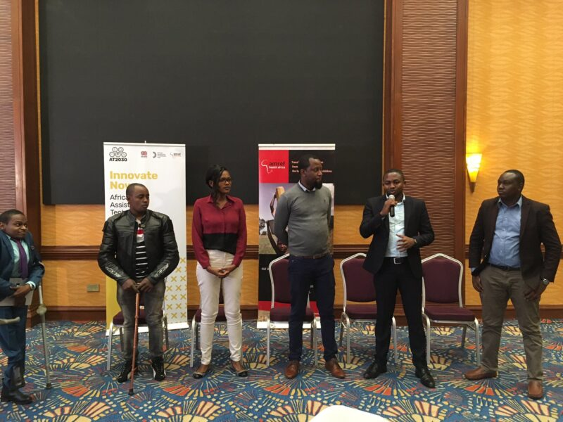 Selected entrepreneurs standing together next to Bernard Chiira, Director of Innovate Now