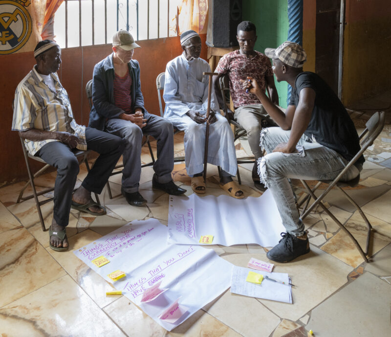 Amadu leads group work with partially sighted participants
