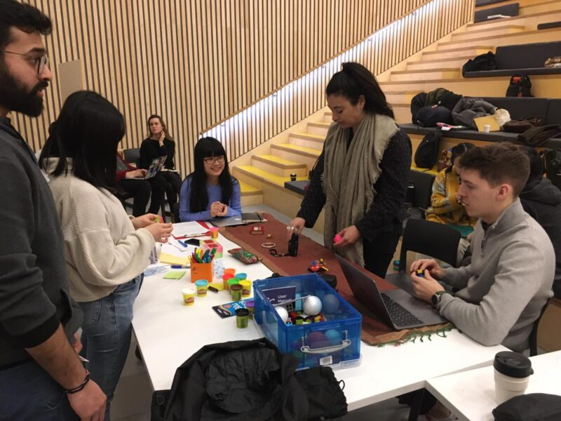 A group of masters students work together in a team.