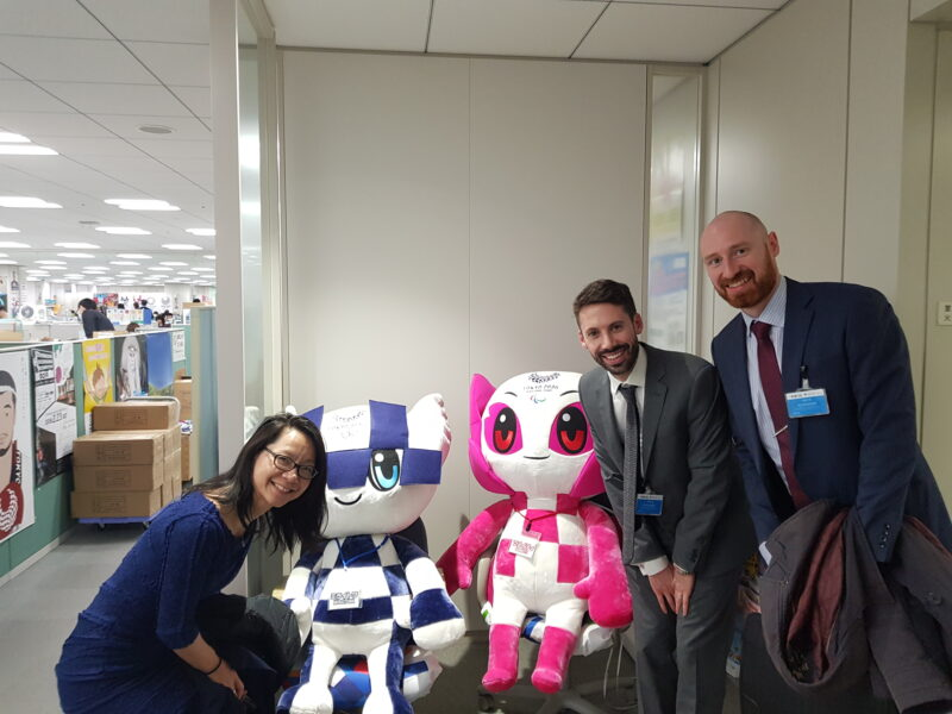 Iain and representatives from British Council and British Embassy posing with the Tokyo 2020 mascots