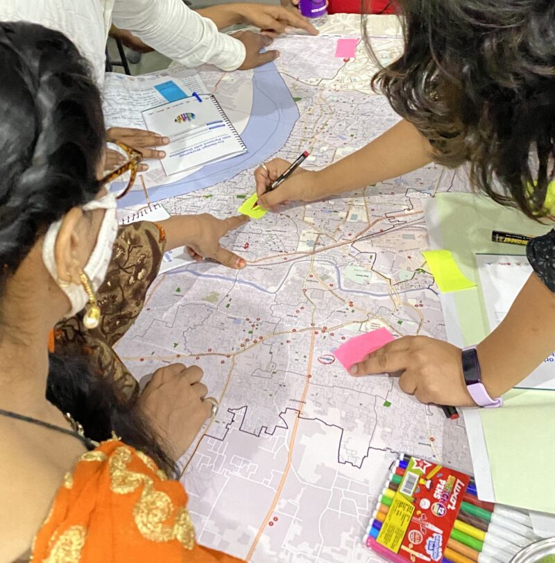 Workshop participants looking on the map and marking locations