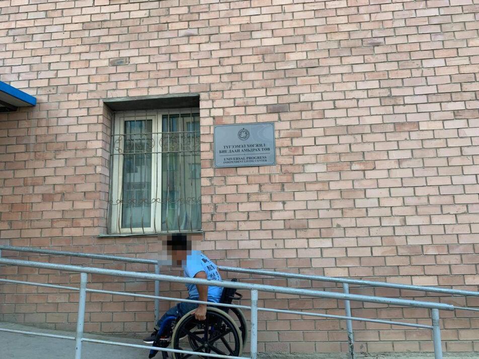 Wheelchair user in a entrance ramp