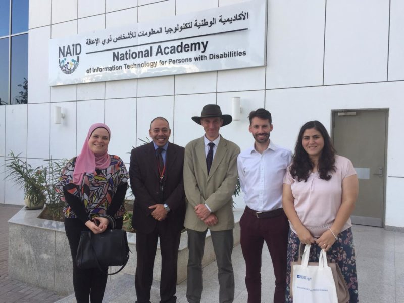 Group photograph of Iain (with a hat) and Tim, with 3 of our partner colleagues - standing outside the National Academy of Information Technology for Persons with Disabilities.