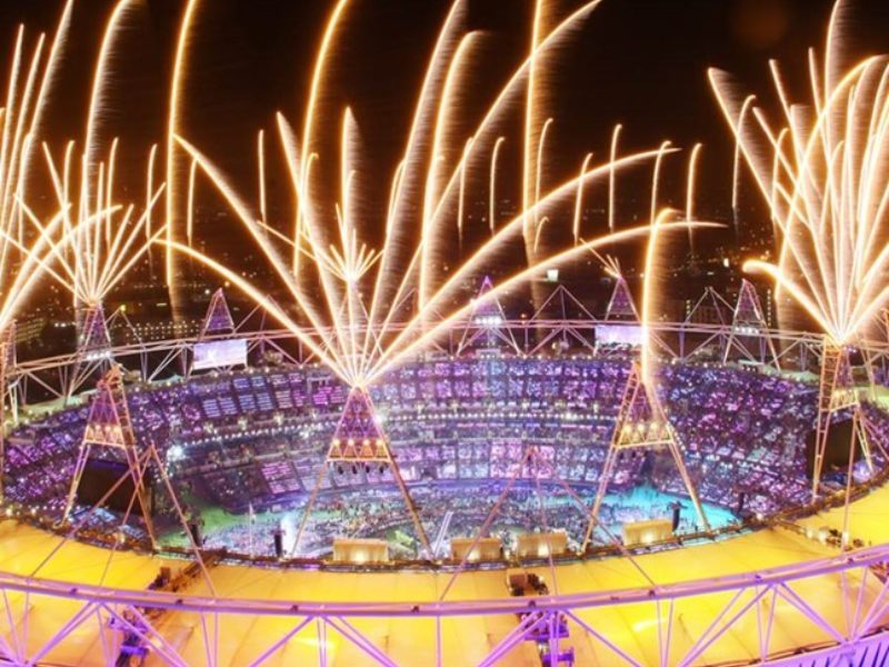 Image shows spectacular fireworks over the Olympic Stadium during the 2012 Games opening ceremony.