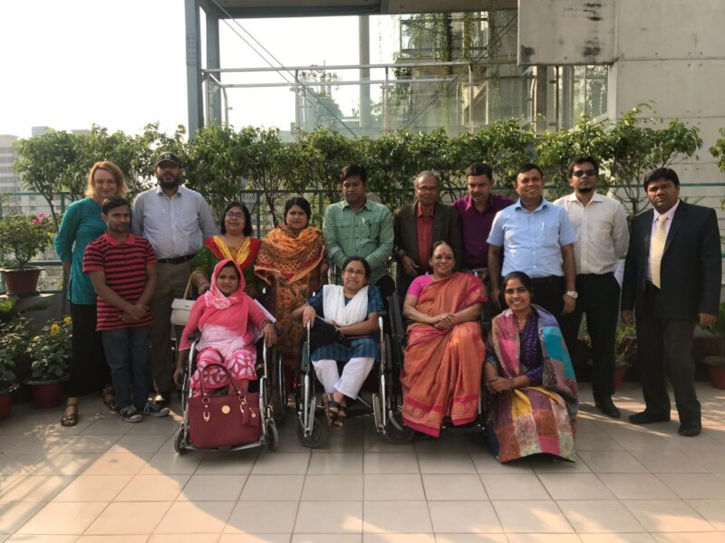 Group of wheelchair users and I2I project staff