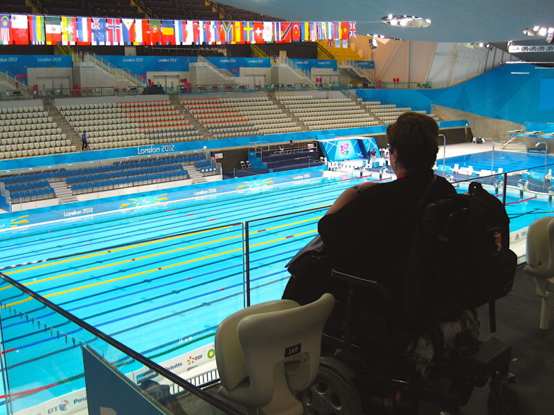 Photograph of Margaret surveying the Olympic and Paralympic pool from a viewing platform