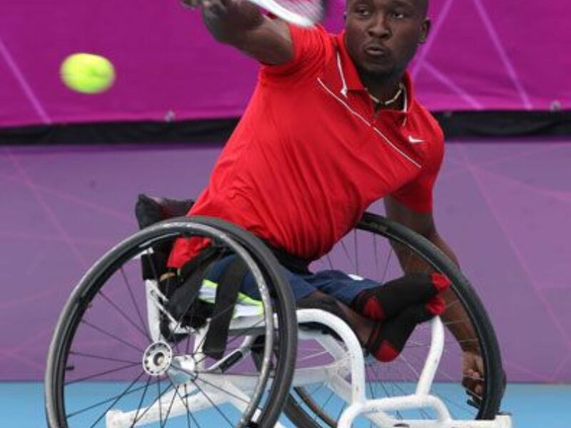 Image of Nyasha, a wheelchair user hitting a ball with a tennis racket at great speed