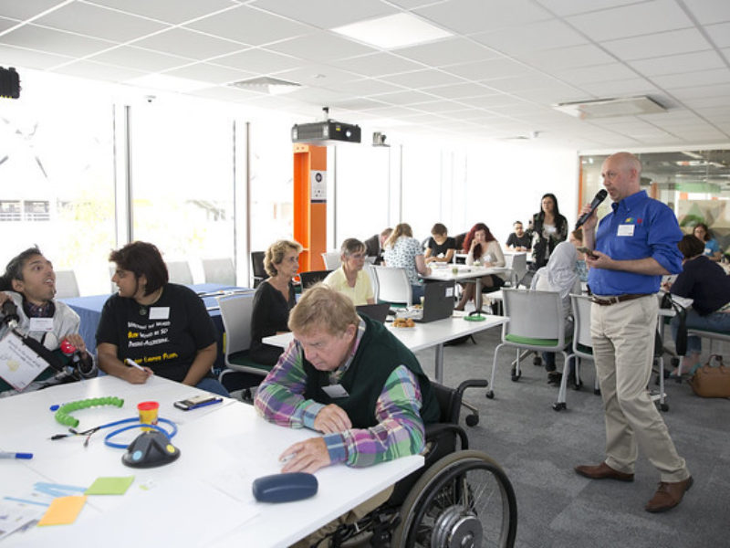 adam, 14:17 Man speaking to the mix of disabled and non-disabled people at the Loughborough University building.
