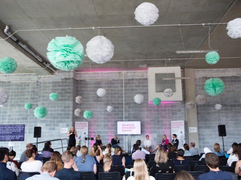 A view of the audience during the Disability Innovation Summit at the HereEast building.
