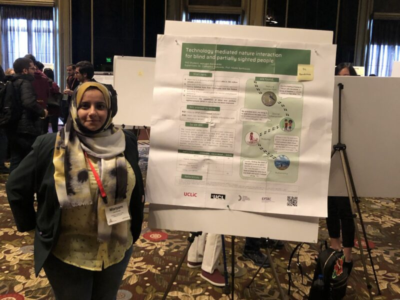 Maryam Bandukda with a poster of her research