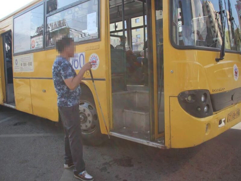 Photograph of a Mongolian man attempting to get on a public bus