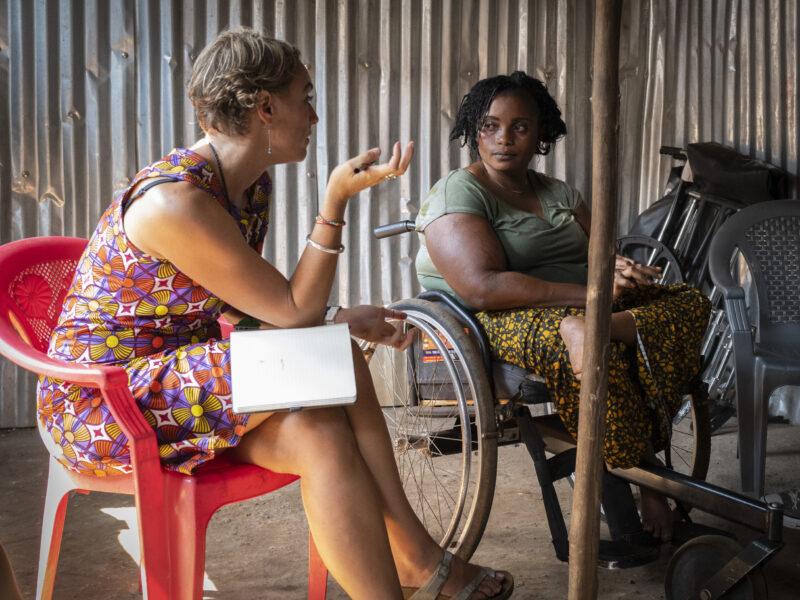 Vicki interviewing a female wheelchair user in Sierra Leone. .