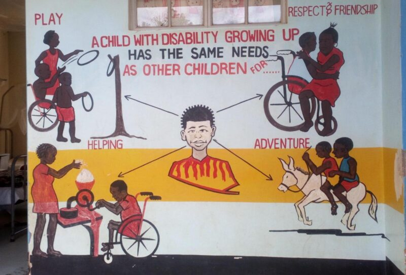 A murial on a wall showing that a child with a disability has the same needs as a child without a disability