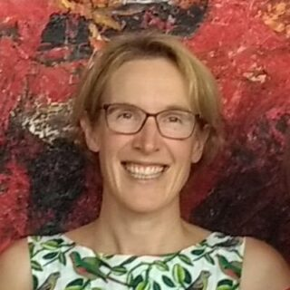 Emma smiling and wearing eyeglasses
